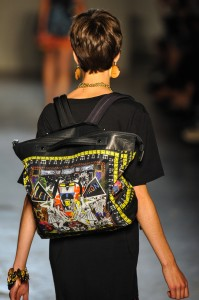Woman on the catwalk wearing funky backpack