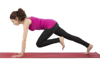 Woman does mountain climber exercise