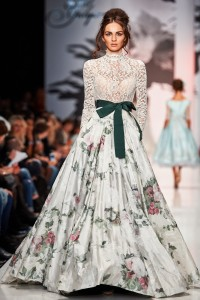 Model walks runway with Victorian-inspired bow and lace