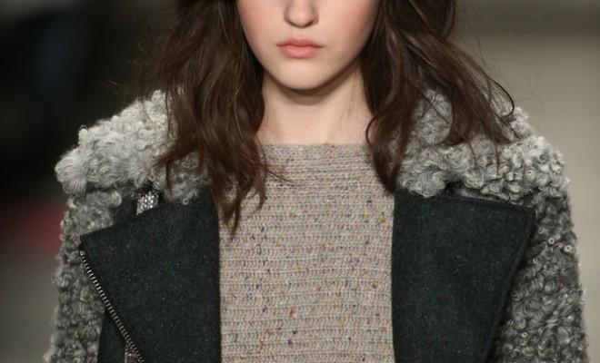 Model walks runway with rosy cheeks