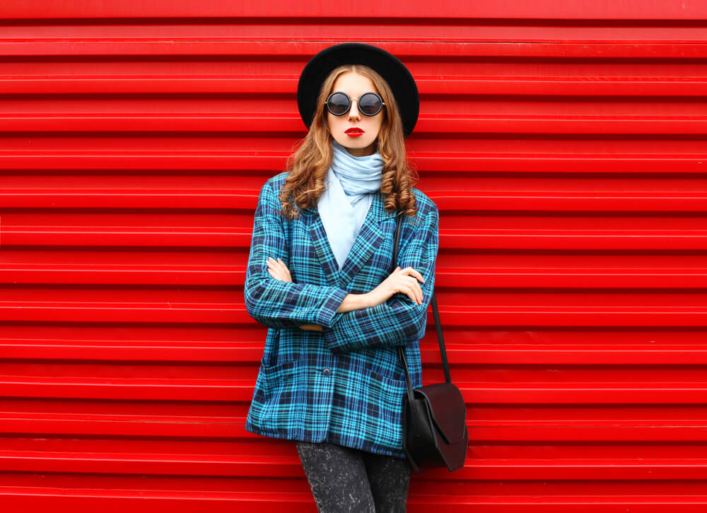 woman in blue checkered coat