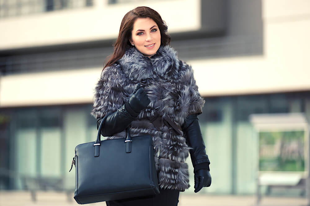 woman in black faux fur jacket