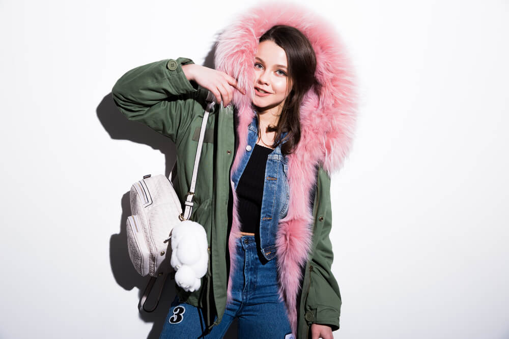 woman in pink furry parka