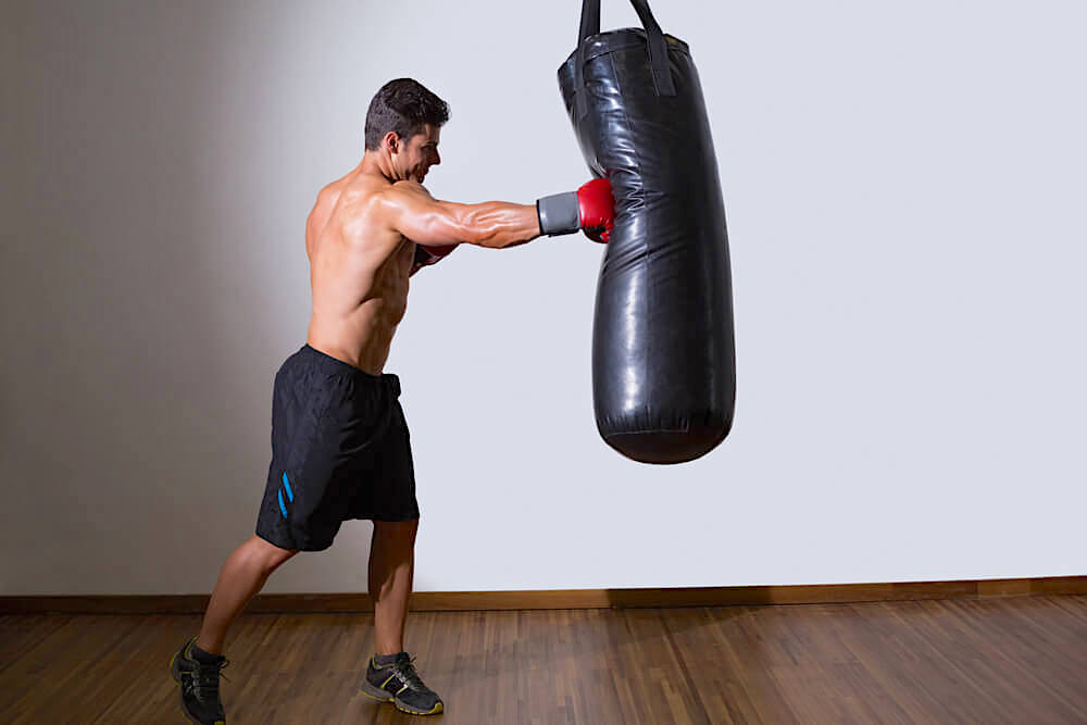 man with punch bag