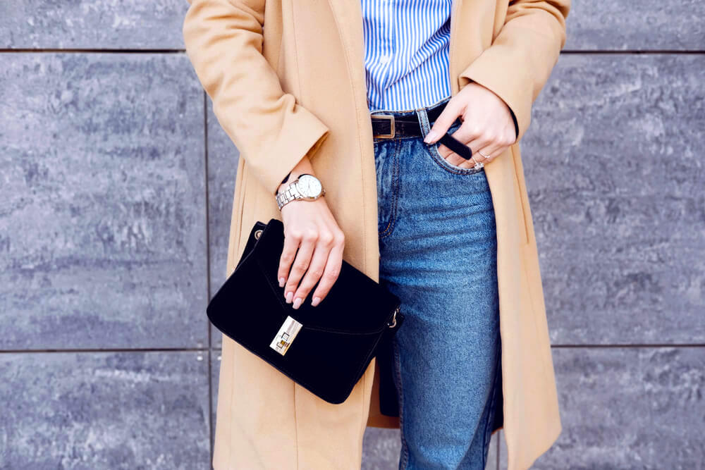 Holding a black purse