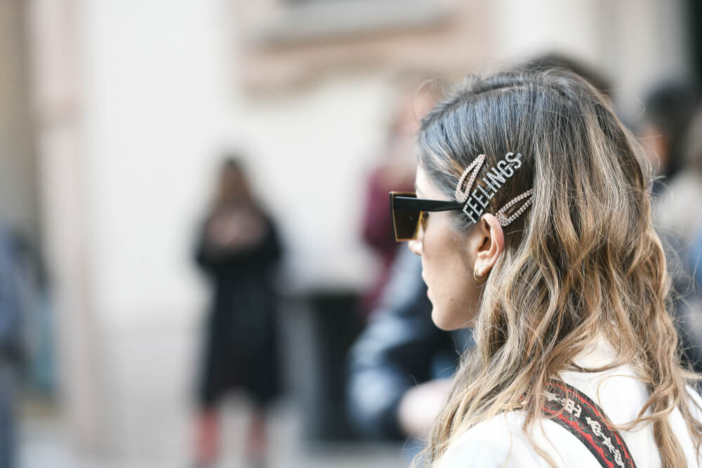Woman with trendy hair clips and bobby pins