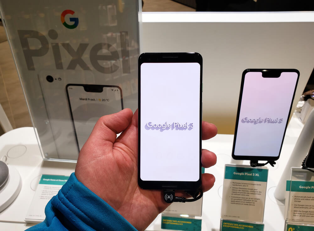 Man holding Google Pixel 3 in store