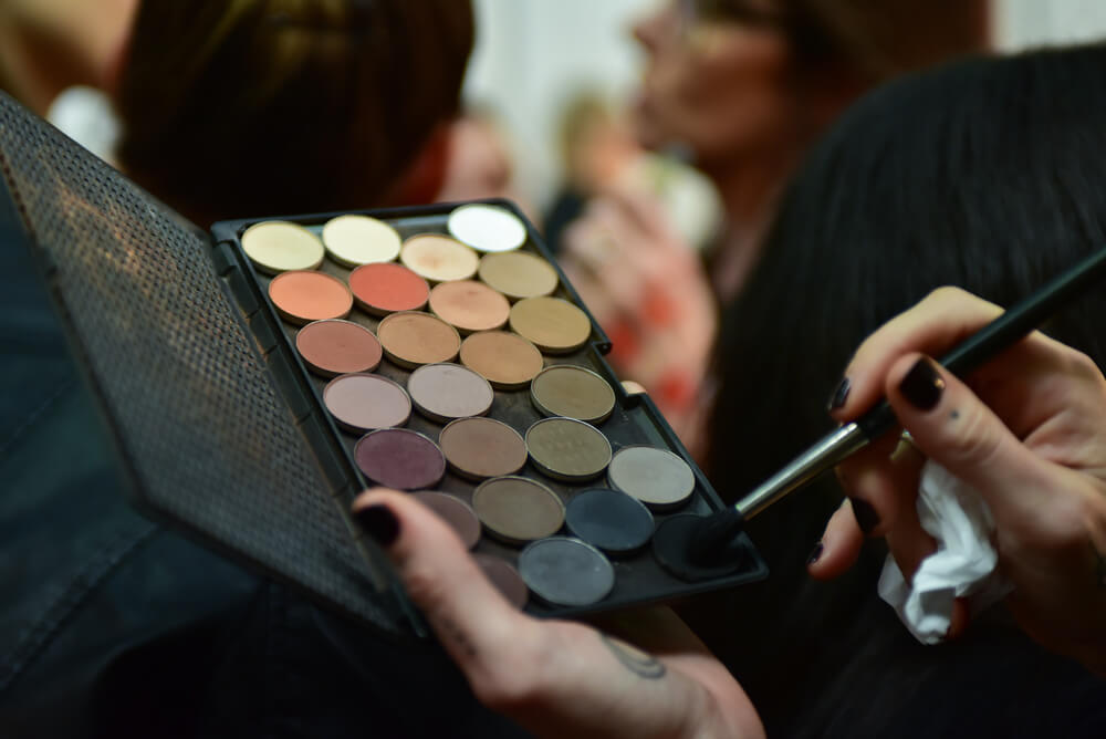 Makeup artist with eyeshadow palette