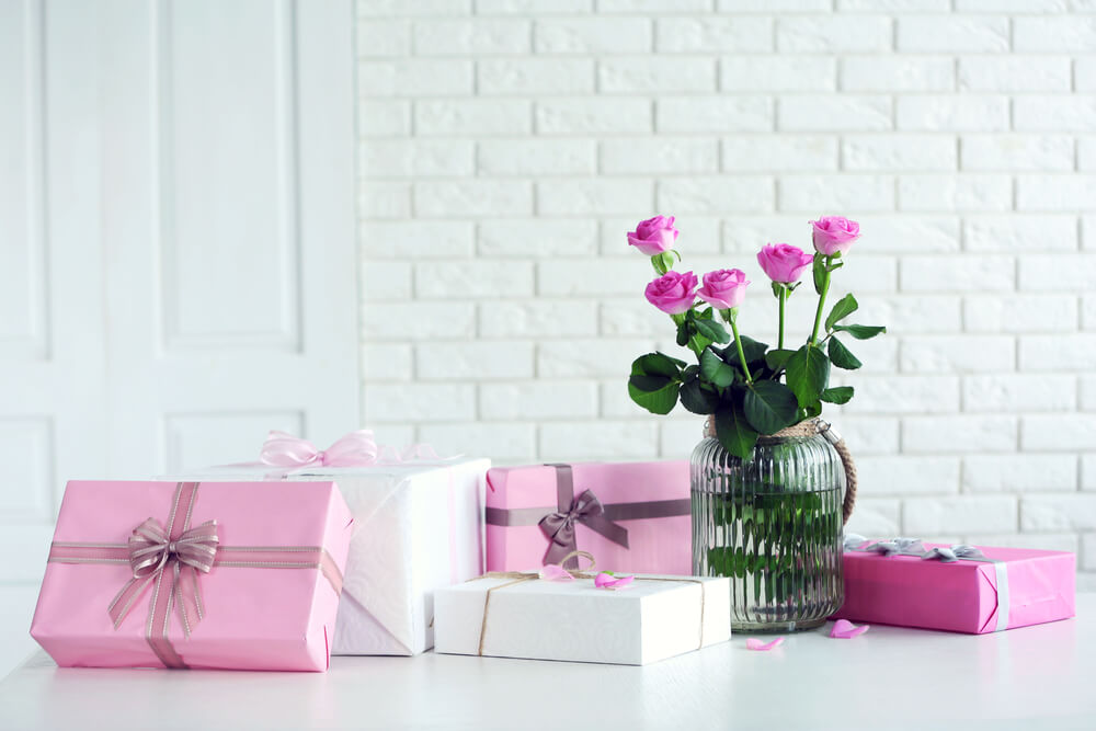 Gifts and flowers on table