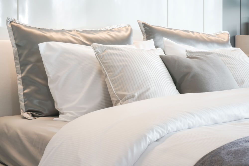 Satin pillowcases on bed