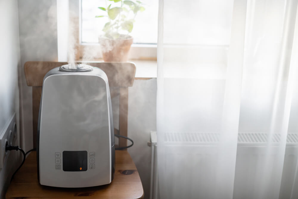 Humidifier on table by window