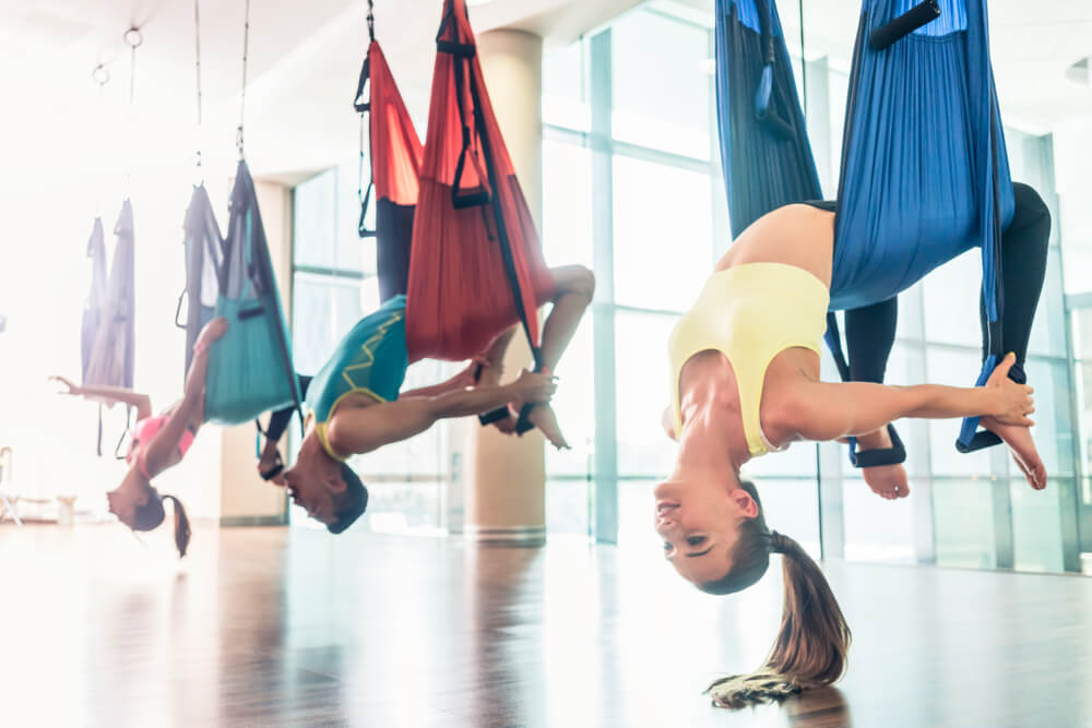 People doing aerial yoga
