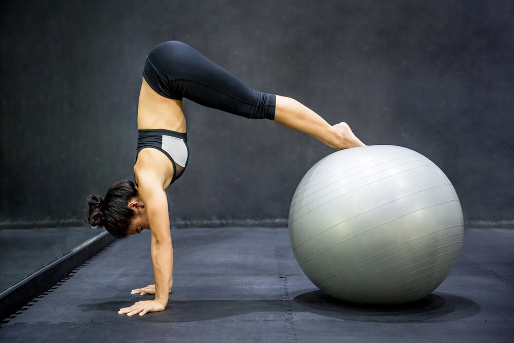 Woman using yoga ball
