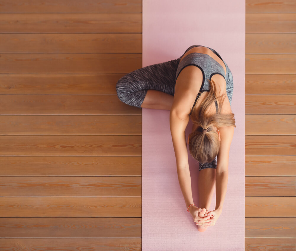 Woman doing yoga on mat