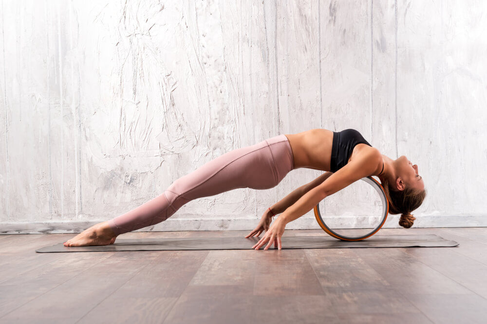 Woman using yoga tube