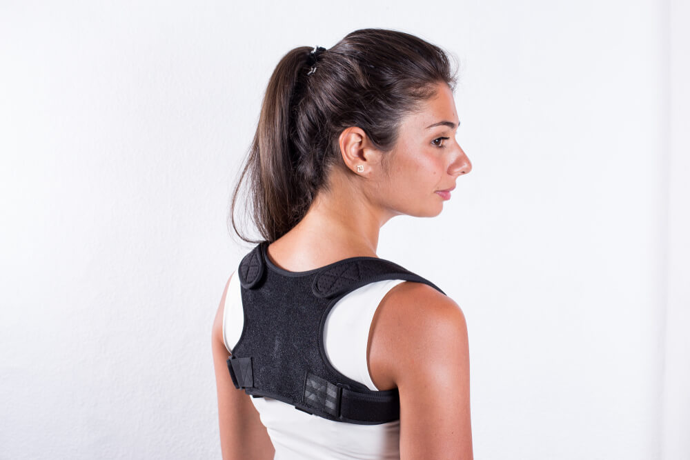 Woman wearing posture support accessory