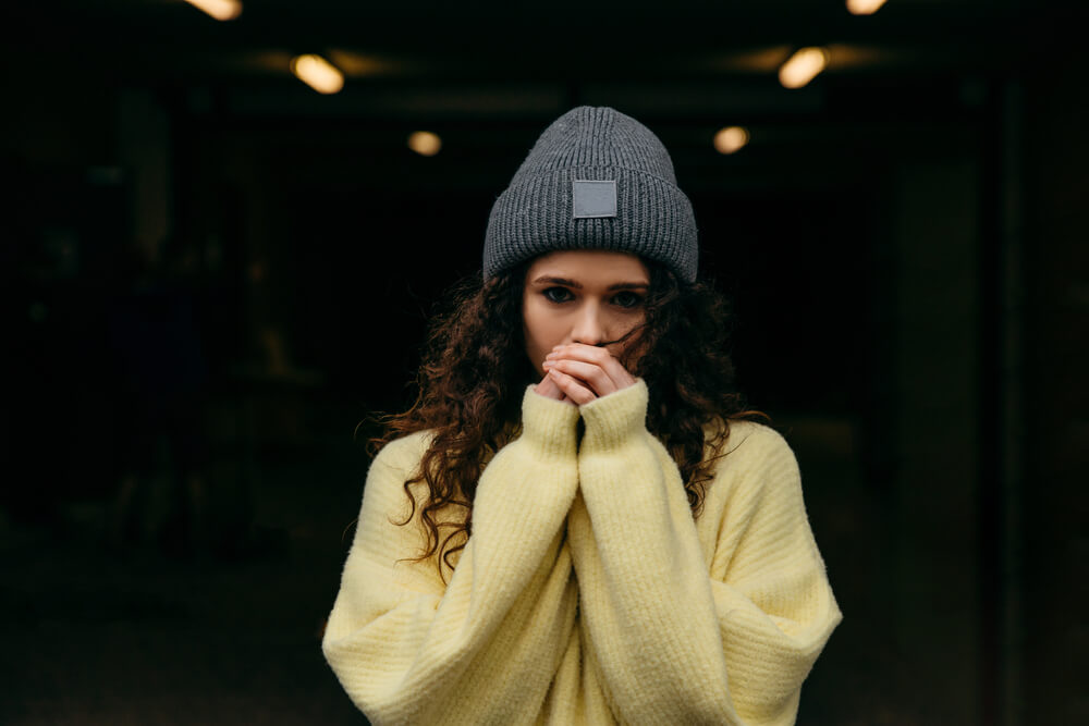 Woman wearing chunky sweater