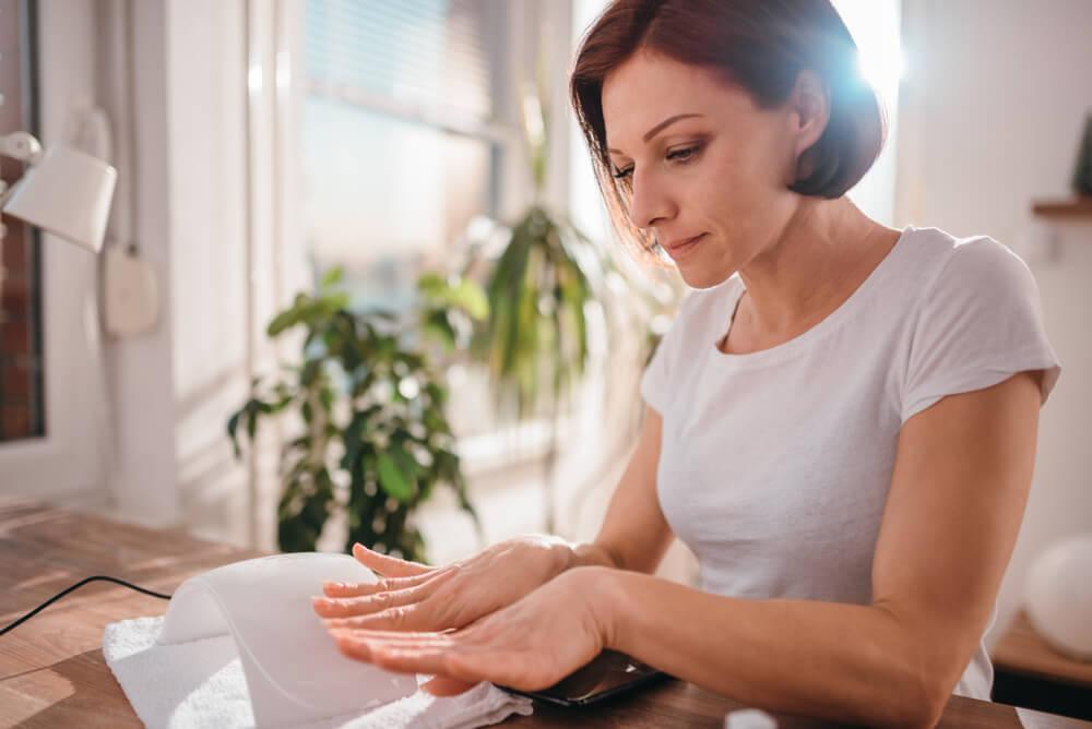 Woman looking at nails