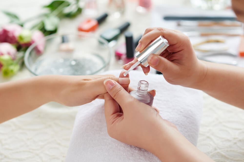 Woman having professional manicure done