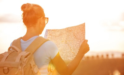 Woman looks at map