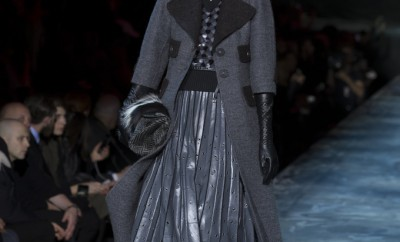 Model walks runway with Victorian-inspired dark colors and long skirt