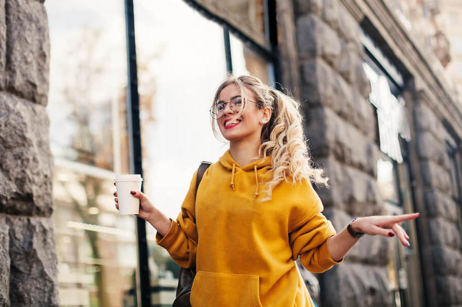 woman in yellow hoodie outdoors