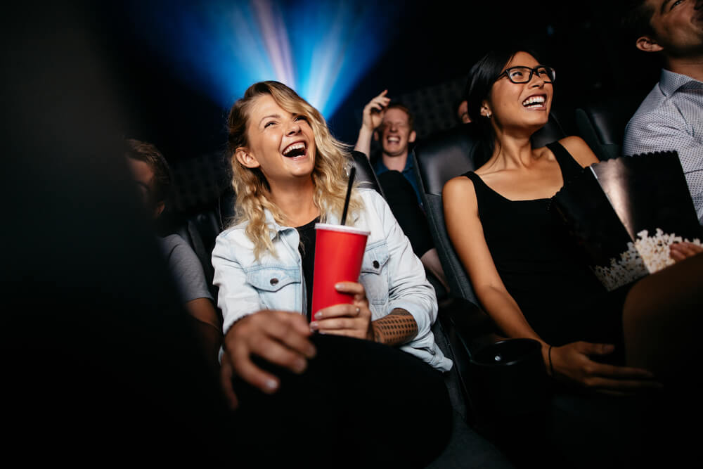 friends watching film in cinema