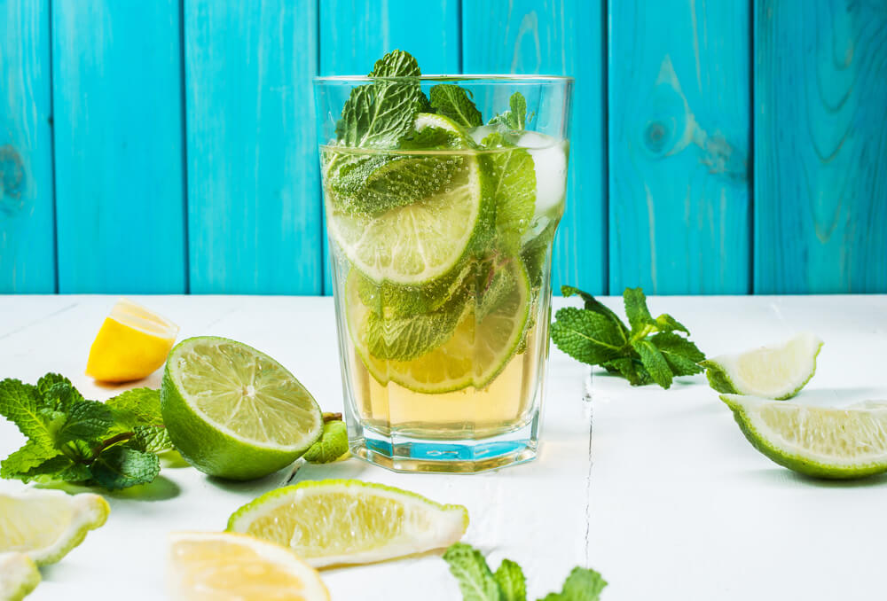 Mojito in a glass with blue wood background