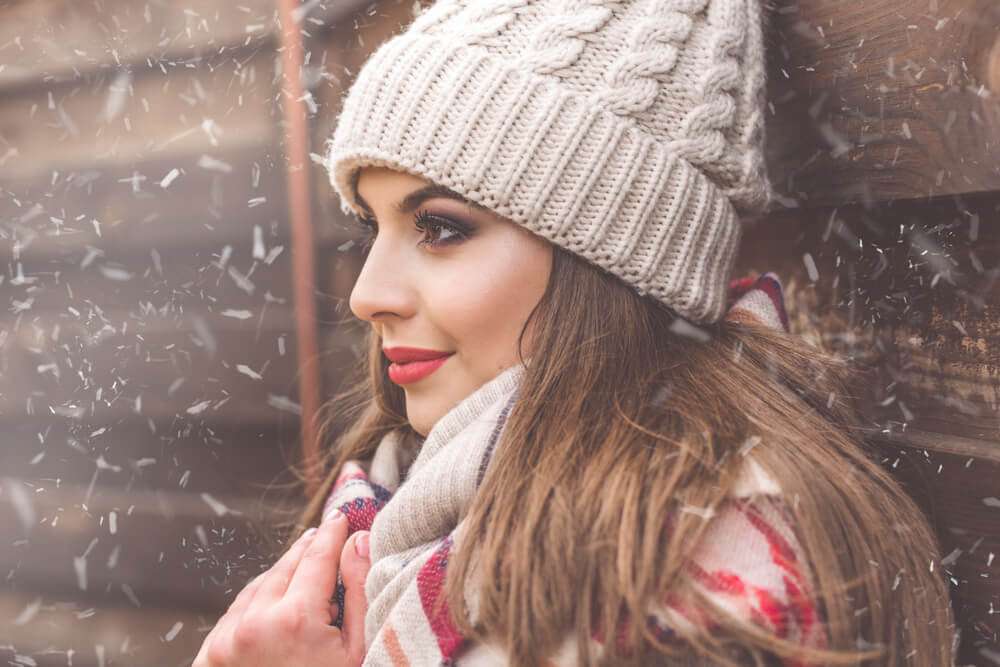 Woman in snow with hat and scarf