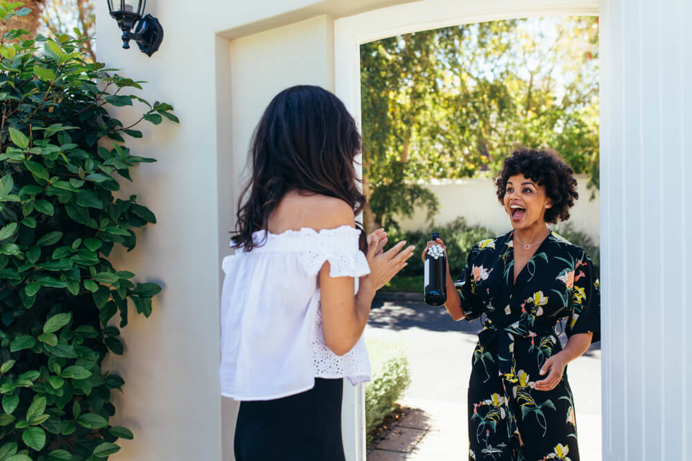 Woman at front door with housewarming gift
